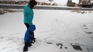 toddler and mother in the snow