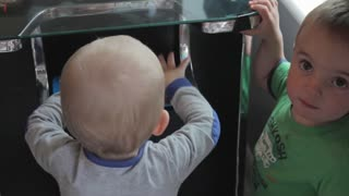 toddlers playing with old arcade