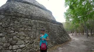 Tourist visiting Ek Balam Mayan ruins in Mexico
