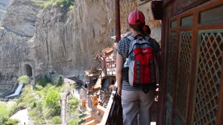 tourist visiting the hanging temple monastery in datong china