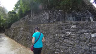 Tourist walks in ancient Mayan ruins at Coba