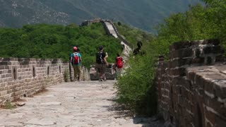 tourists hiking along great wall of china jiankou section
