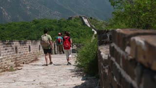 tourists hiking great wall of china on a mountain jiankou section