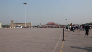 tourists in tiananmen square in beijing china