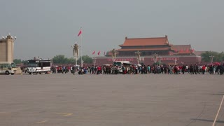 tourists in tiananmen square waiting to see mao zedongs body