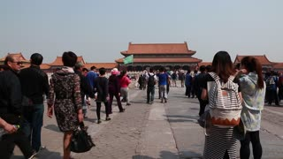 tourists inside the gates of the forbidden city