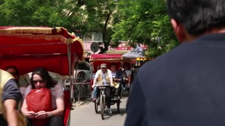 tourists on rickshaw bikes in beijing china