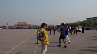 tourists taking photos in tiananmen square china