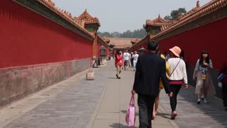 Tourists viewing buildings inside the Forbidden City Beijing China