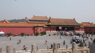 tourists viewing the forbidden city in courtyard in beijing china