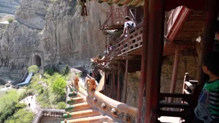 tourists visiting the hanging temple monastery at datong china