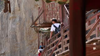 tourists visiting the hanging temple monastery in datong china