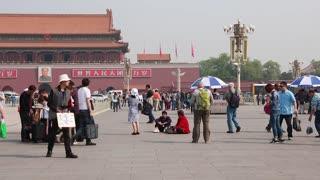 tourists walking in tiananmen square in beijing china