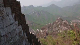 towers and great wall of china on a mountain ridge