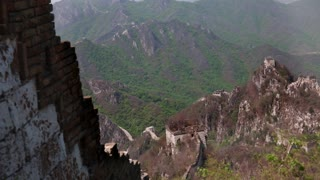 towers and the great wall of china on a mountain ridge