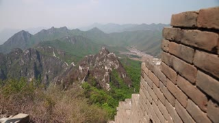 towers of the great wall of china on a mountain ridge