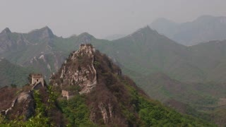 towers on the great wall of china on a mountain ridge