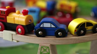 toy trains and cars on track