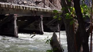 Train bridge over flooding river