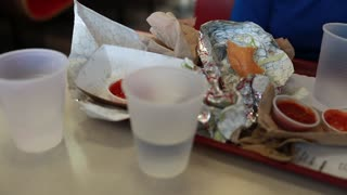 trash at fast food restaurant on table