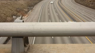 Trucks and cars driving on I-80 highway timelapse dolly shot