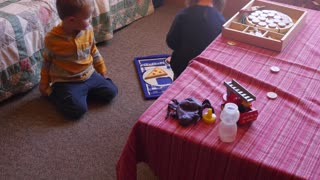 Two toddlers playing together in a room