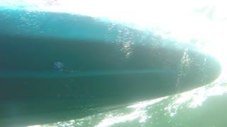Underwater shot of a sea kayak on surface of ocean