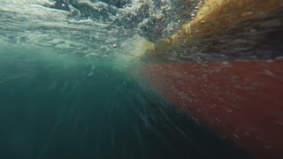 Underwater shot of bubbles passing by a fishing boat hull