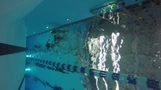 Underwater shot of children swimming at the swimming pool