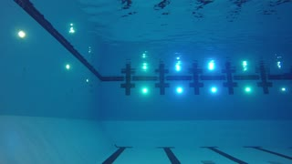 Underwater shot of deep swimming pool with lights