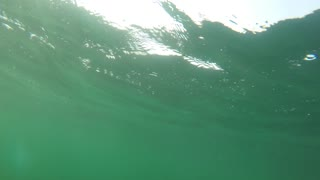 Underwater shot of rough ocean waves