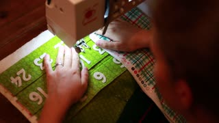 using a sewing machine to make advent calendar