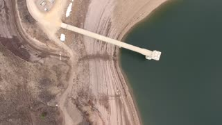Very high rotating aerial of low mountain reservoir and dam