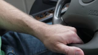 A Hand And Steering Wheel In A Car Driving Fast On Highway