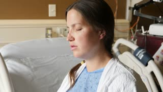 A Handheld Shot Of A Woman In A Hospital Bed In Labor