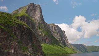 A Huge Tall Rocky Granite Cliffs Western Brook Pond In Gros Morne