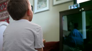 A Little Boy Plays With Video Game Console