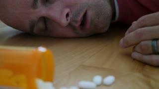 A Man Lies On A Floor After Prescription Drug Overdose