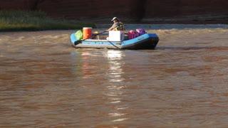 A Man Rafts Down The Colorado River