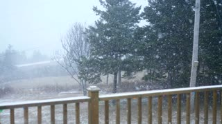 A slow motion shot of a winter storm outside the house