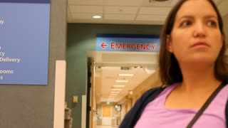 A woman waiting in the emergency room at the hospital