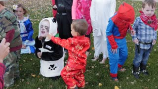 Adorable Children Dressed Up For A Halloween Party