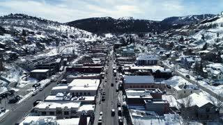Aerial Amazing Shot Of People In A Winter Mountain Resort Town In Utah