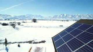 Aerial Dolly Of A House With Solar Panels During The Winter