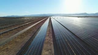Aerial Dolly Shot Flying Above The Large Solar Farm In A Dry Desert