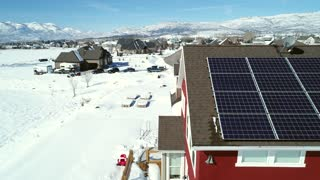 Aerial Dolly Shot Of A House With Solar Panels In The Winter
