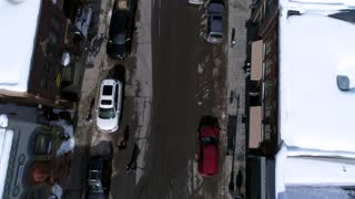 Aerial Dolly Shot Of A Road In A Winter Mountain Resort Town In Utah