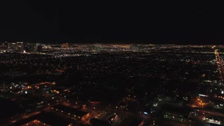 Aerial Establishing Shot Las Vegas City Bright Lights At Night Panning