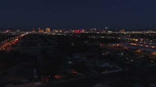 Aerial Establishing Shot Of Bright Las Vegas City Lights At Night