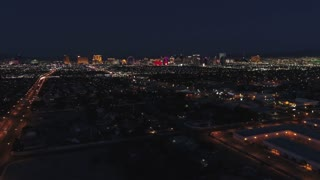 Aerial Establishing Shot Of The Bright Las Vegas City Lights At Night